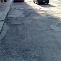 Via Bizet: una strada colabrodo